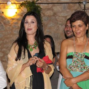 Mrs.Maria Tsompanaki between Christos and Eva